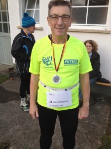 Ulrich Tomaschewski mit Finisher-Medaille in Weilheim